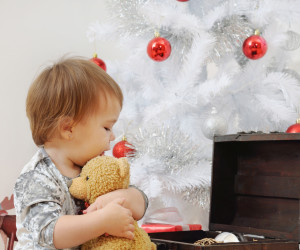portrait of cute little baby girl playing with Christmas toys